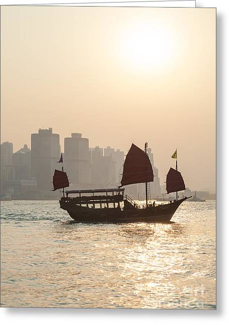 Kowloon Greeting Cards - Traditional junk boat sailing in Hong Kong harbor Greeting Card by Matteo Colombo