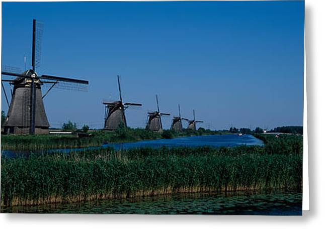Environmental Conservation Greeting Cards - Traditional Windmills At A Riverbank Greeting Card by Panoramic Images