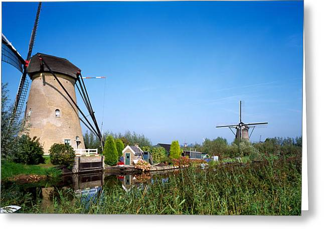 Windmill And Tree Greeting Cards - Traditional Windmills In A Field Greeting Card by Panoramic Images
