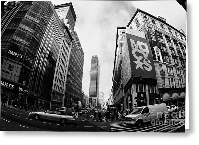 traffic crossing intersection outside Macys at Broadway and 34th Street Herald Square new york usa Greeting Card by Joe Fox