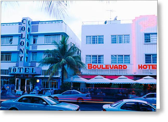 Awning Photographs Greeting Cards - Traffic On Road In Front Of Hotels Greeting Card by Panoramic Images
