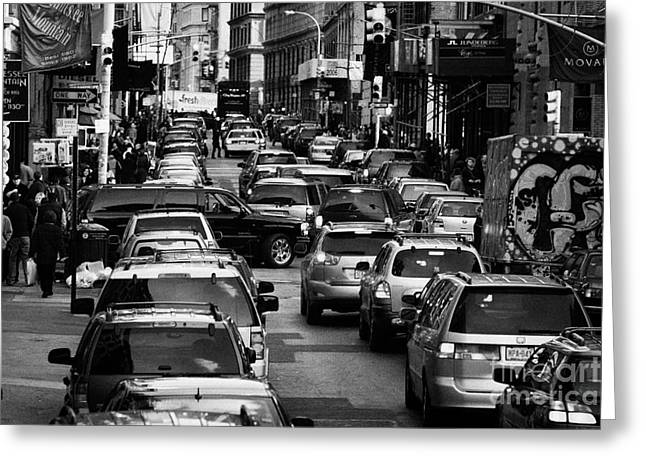Manhaten Greeting Cards - Traffic Queued Up On 6th Avenue In Soho New York City Greeting Card by Joe Fox