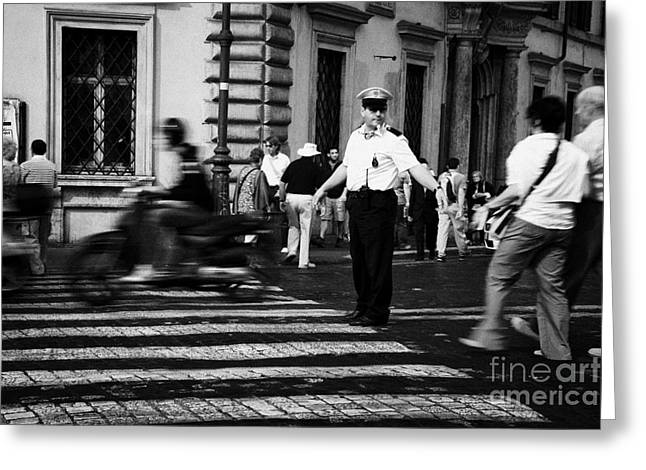 Police Officer Greeting Cards - traffic speeds past as Roman Municipal policeman directs pedestrians across the road at a pedestrian crossing in the Via Teatro Marcello Rome Lazio Italy Greeting Card by Joe Fox