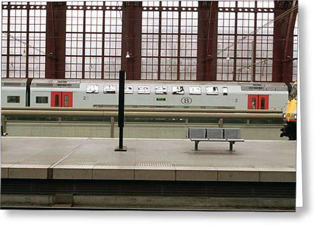 Public Transportation Greeting Cards - Trains At A Railroad Station Platform Greeting Card by Panoramic Images
