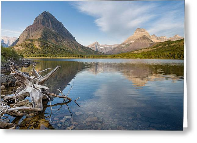 Cloud Reflections In Water Greeting Cards - Tranquil Morning on Swiftcurrent Lake Greeting Card by Greg Nyquist
