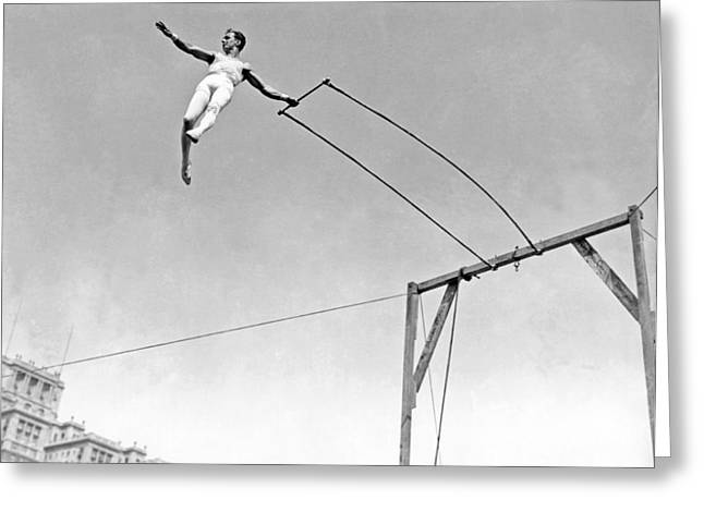 Trapeze Artist On The Swing Greeting Card by Underwood Archives