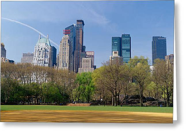 Park Scene Greeting Cards - Trees In A Park With Buildings Greeting Card by Panoramic Images