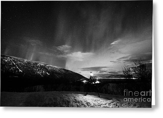 Photographing Aurora Greeting Cards - Tripod And Camera Set Up To Photograph Swirling Northern Lights Aurora Borealis Near Tromso In North Greeting Card by Joe Fox