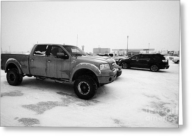 Car Park Greeting Cards - truck and cars parked in store parking lot in snowstorm blizzard Saskatoon Saskatchewan Canada Greeting Card by Joe Fox