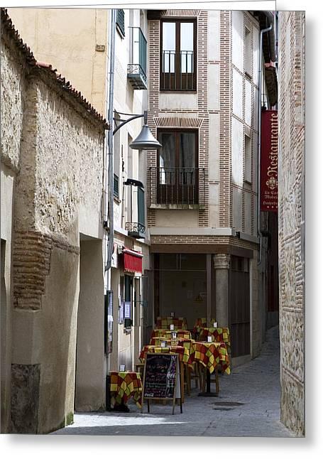 True Cross Photographs Greeting Cards - Tucked Segovia Cafe Greeting Card by Lorraine Devon Wilke