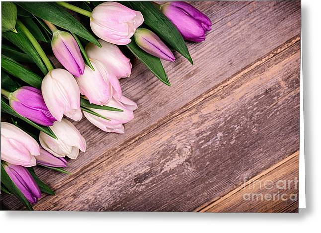 Easter Flowers Greeting Cards - Tulips over old wood Greeting Card by Jane Rix