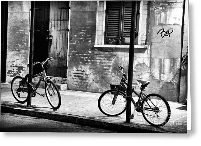 Two Bikes Greeting Cards - Two Bikes at Night Greeting Card by John Rizzuto