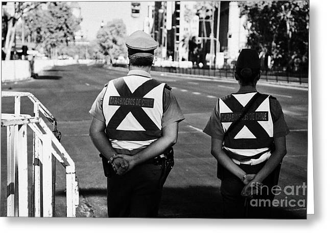 Policewoman Greeting Cards - two carabineros de chile national police officers with roads closed Santiago Chile Greeting Card by Joe Fox