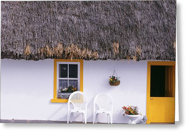 Entrance Door Greeting Cards - Two Chairs Outside A Cottage, County Greeting Card by Panoramic Images