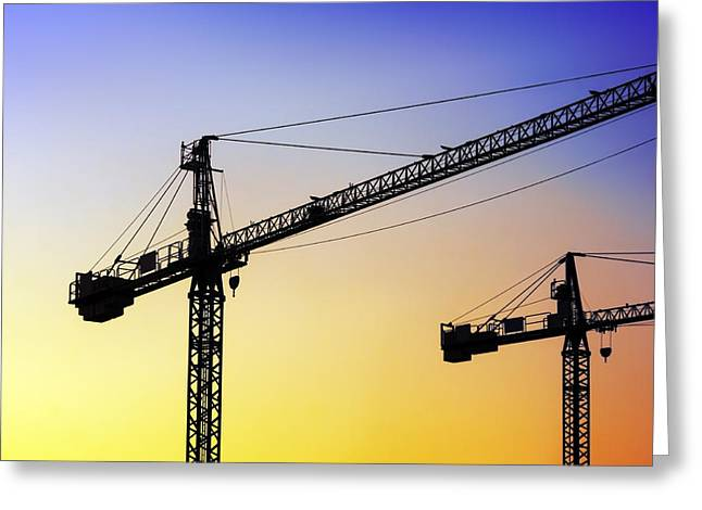 Tower Crane Greeting Cards - Two Cranes At Sunset Greeting Card by Mikel Martinez de Osaba