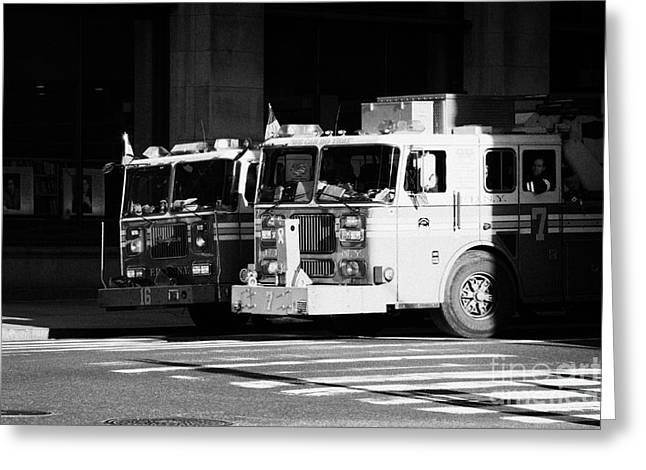 Manhaten Greeting Cards - two FDNY fire engines 16 and 7 wait beside crosswalk 34th Street new york city Greeting Card by Joe Fox