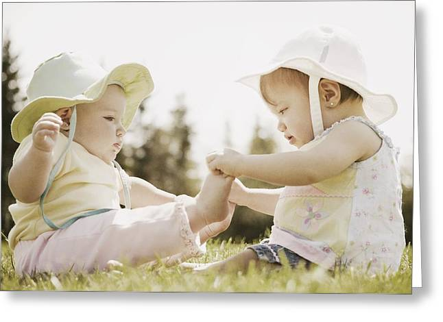 Two Girls Sit Together Greeting Card by Don Hammond