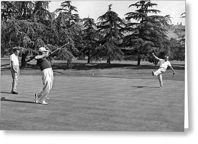 Legs Up Greeting Cards - Two Golfers Body English Greeting Card by Underwood Archives
