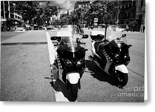 Police Motorcycles Greeting Cards - two guardia urbana city police patrol motorbikes on passeig de gracia Barcelona Catalonia Spain Greeting Card by Joe Fox