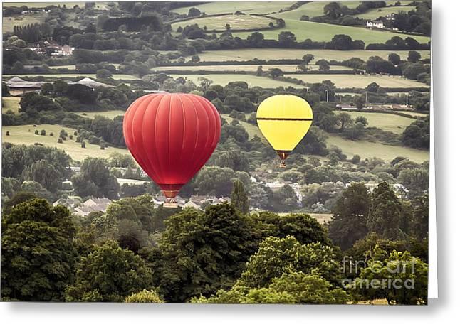 Balloon Aircraft Greeting Cards - Two hot air baloons drifting Greeting Card by Simon Bratt Photography LRPS