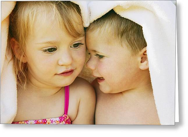 Beach Towel Photographs Greeting Cards - Two Kids Snuggle Under A Towel Greeting Card by Don Hammond