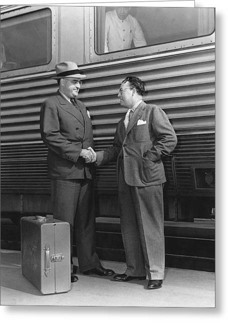 Shaking Hands Greeting Cards - Two Men Shaking Hands At Train Greeting Card by Underwood Archives