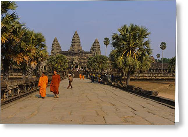 Siem Reap Greeting Cards - Two Monks Walking In Front Of An Old Greeting Card by Panoramic Images