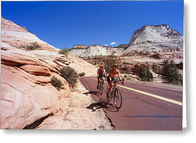 Two People Cycling On The Road, Zion Greeting Card by Panoramic Images