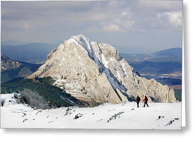 Pais Vasco Greeting Cards - Two people hiking on mountain with snow in winter Greeting Card by Mikel Martinez de Osaba