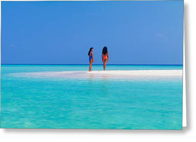 Sandbar Greeting Cards - Two Women Standing On The Beach Greeting Card by Panoramic Images
