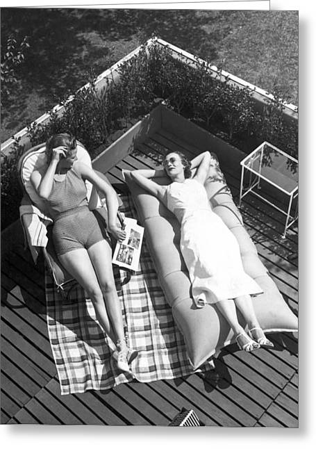 Two Women Sunbathing Greeting Card by Underwood Archives