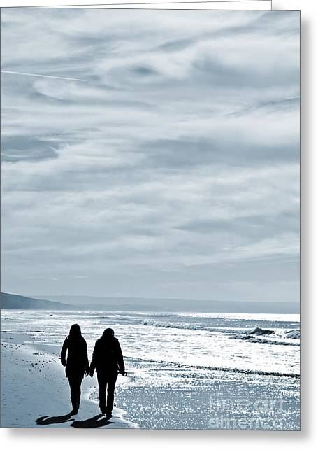 Gay Relationship Greeting Cards - Two Women Walking At The Beach In The Winter Greeting Card by Jose Elias - Sofia Pereira