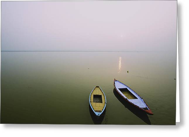 Boats On Water Greeting Cards - Two Wooden Boats Sit On The Tranquil Greeting Card by Chris Caldicott