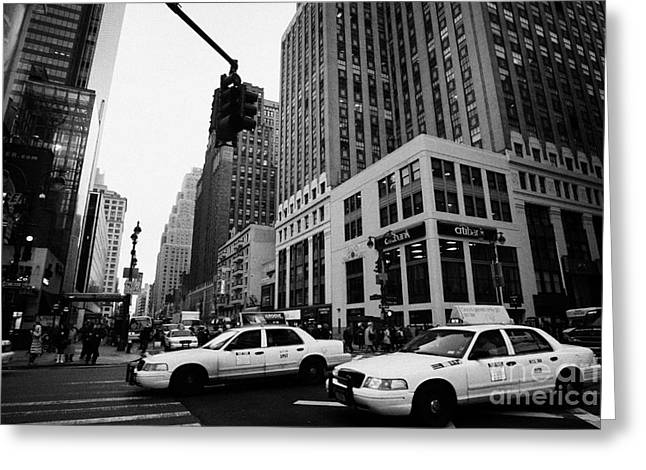 two yellow cabs cross intersection between seventh 7th avenue and 34th street new york city Greeting Card by Joe Fox