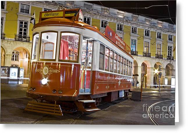Tram Red Greeting Cards - Typical Lisbon tram in Commerce Square Greeting Card by Jose Elias - Sofia Pereira