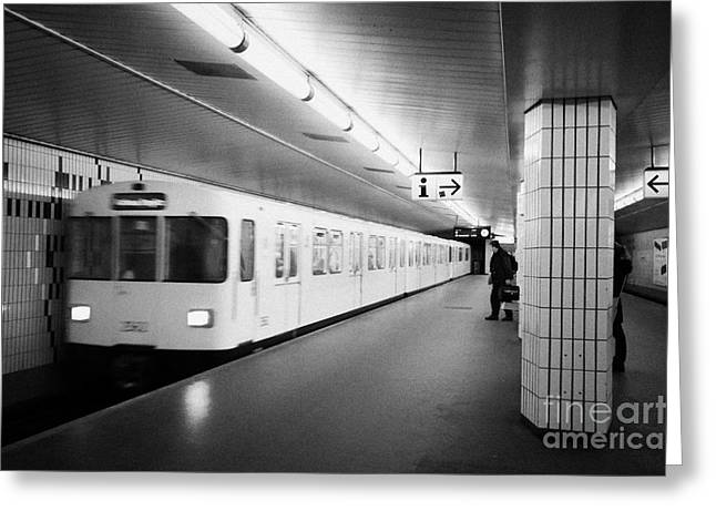 Berlin Germany Greeting Cards - u-bahn train pulling in to ubahn station Berlin Germany Greeting Card by Joe Fox