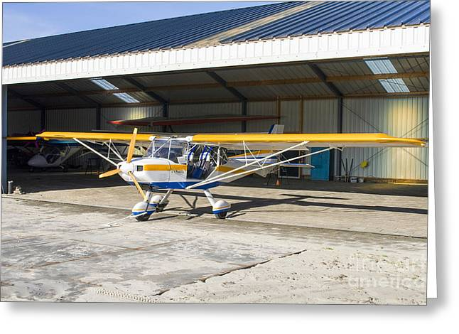 Plane Nose Greeting Cards - Ultralight Plane In Hangar Greeting Card by Patricia Hofmeester