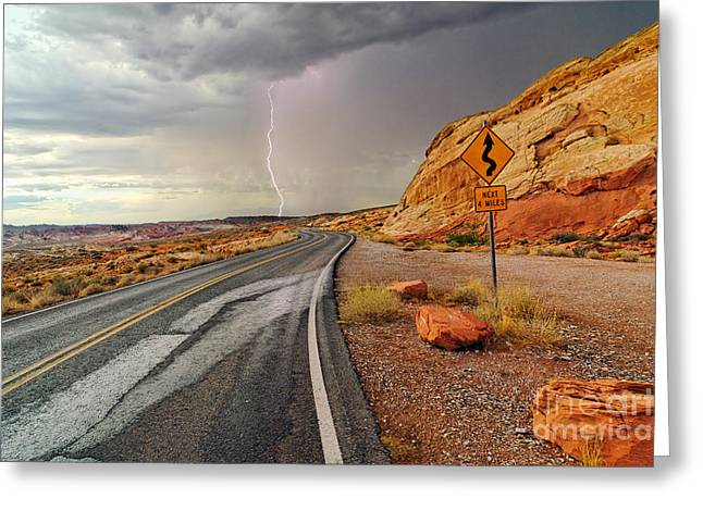 Desert Storm Greeting Cards - Uncertainty - Lightning striking during a storm in the Valley of Fire State Park in Nevada. Greeting Card by Jamie Pham