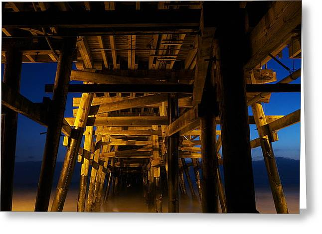 Beach At Night Greeting Cards - Under the Pier at Night Greeting Card by Richard Cheski