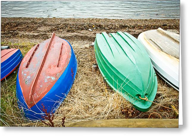 Dinghy Greeting Cards - Upturned boats Greeting Card by Tom Gowanlock