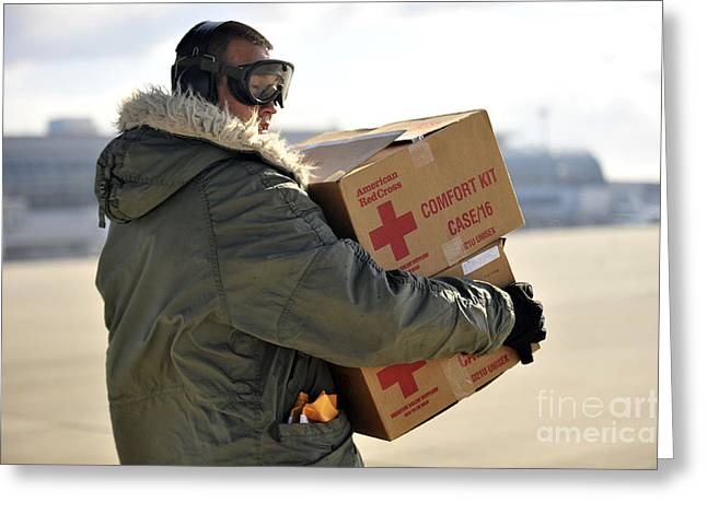 Cardboard Greeting Cards - U.s. Air Force Airman Carries American Greeting Card by Stocktrek Images