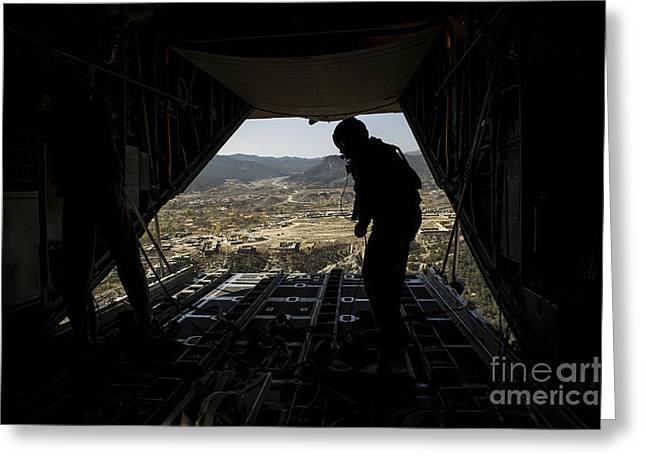 Us Open Photographs Greeting Cards - U.s. Air Force Airman Pushes Greeting Card by Stocktrek Images