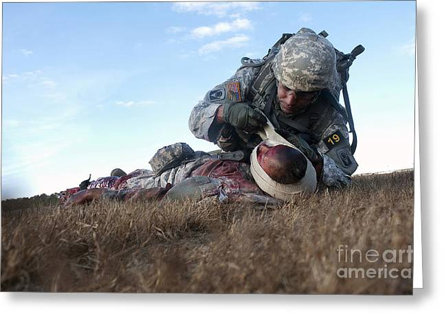 Hurting Head Greeting Cards - U.s. Army Infantryman Bandages An Greeting Card by Stocktrek Images