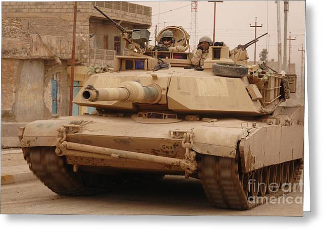 Us Army Tank Greeting Cards - U.s. Army M1 Abrams Tank Conducts Greeting Card by Stocktrek Images