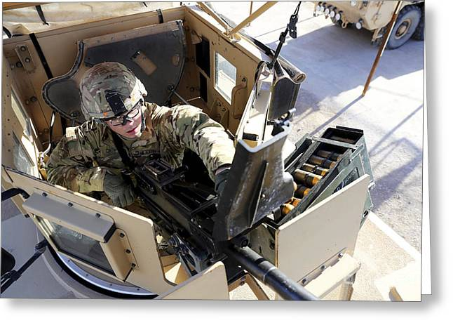 Up-armored Greeting Cards - U.s. Army Soldier Checks A Mk-19 Greeting Card by Stocktrek Images