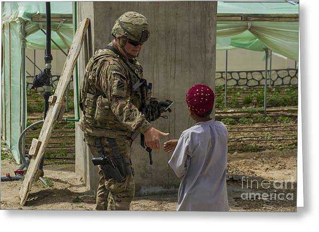 Cooperation Greeting Cards - U.s. Army Soldier Greets An Afghan Greeting Card by Stocktrek Images