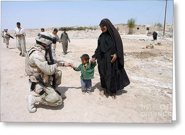 Citizens Greeting Cards - U.s. Army Soldiers Hand Out Treats Greeting Card by Stocktrek Images
