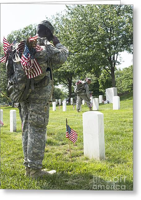 Place Of Burial Greeting Cards - U.s. Army Soldiers Place Flags In Front Greeting Card by Stocktrek Images