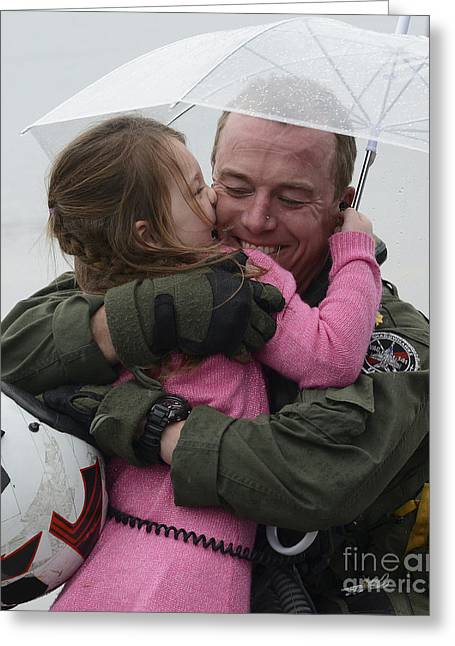 Family With One Child Greeting Cards - U.s. Aviator Hugs His Daughter Greeting Card by Stocktrek Images