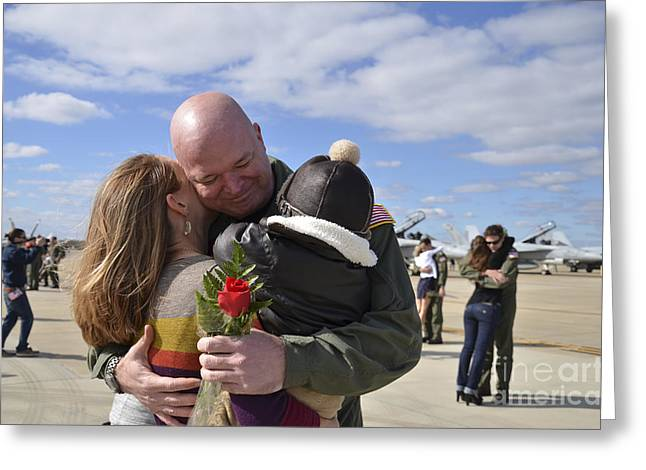 Family With One Child Greeting Cards - U.s. Aviator Is Greeted By His Wife Greeting Card by Stocktrek Images